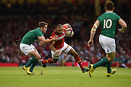Eli Walker of Wales © is tackled by Ireland's Eoin Reddan (l) . Wales v Ireland rugby union international, RWC warm up friendly match at the Millennium Stadium in Cardiff, South Wales on Saturday 8th August  2015.<br /> pic by Andrew Orchard, Andrew Orchard sports photography.