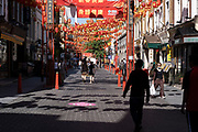 Gerrard Street in Chinatown remains very quiet with a few people visiting Chinese restaurants to pick up food and to see the red lanterns on 26th June 2020 in London, England, United Kingdom. As the July deadline approaces and government will relax its lockdown rules further, the West End remains quiet, while some non-essential shops are allowed to open with individual shops setting up social distancing systems.