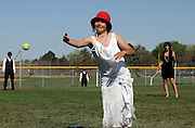 pvc042111a/4-21-11/asec.  Megan Archuleta (CQ), center age 17, pitches a tennis ball to a classmate during a game of baseball as students in Kathy Browning and Vladi Stanojevic's (Both not pictured) humanities classes participate in the Great Gadsby Gala at Sandia High School, photographed Thursday April 21, 2011.  Playing the infield and outfield are (L-R) Kevin Montgomery (CQ), Jesse Funnell (CQ), and Alex Arellano (CQ).  In anticipation of Thursday's festivities students researched the 1920's by reading F. Scott Fitzgerald's literary classic The Great Gatsby; students surveyed the clothing fashion of the period, the popular musical trends of the time, and historical events of the '20's including the stock market crash, the creation of Mt. Rushmore, the effect prohibition had on the country, and the increase in popularity the sport of golf enjoyed.  Students dressed in the period clothing.  (Pat Vasquez-Cunningham/Journal)