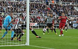 01 October 2017 Newcastle: Premier League Football: Newcastle United v Liverpool:  Newcastle captain Jamaal Lascelles clears a close range shot by Dejan Lovren from the goal area.<br /> Photo: Mark Leech