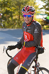 Patrick Dempsey walks with his mother in road run for his fundraiser to fight cancer, inspired by his mother's battle with cancer, in hometown in Lewiston, Maine, the Dempsey Challenge includes a road run followed next day with bicycle ride up to 100 miles.