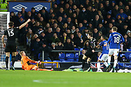 Theo Walcott of Everton (11) slots the ball past Leicester City Goalkeeper Kasper Schmeichel to score his teams 2nd goal. Premier league match, Everton v Leicester City at Goodison Park in Liverpool, Merseyside on Wednesday 31st January 2018.<br /> pic by Chris Stading, Andrew Orchard sports photography.
