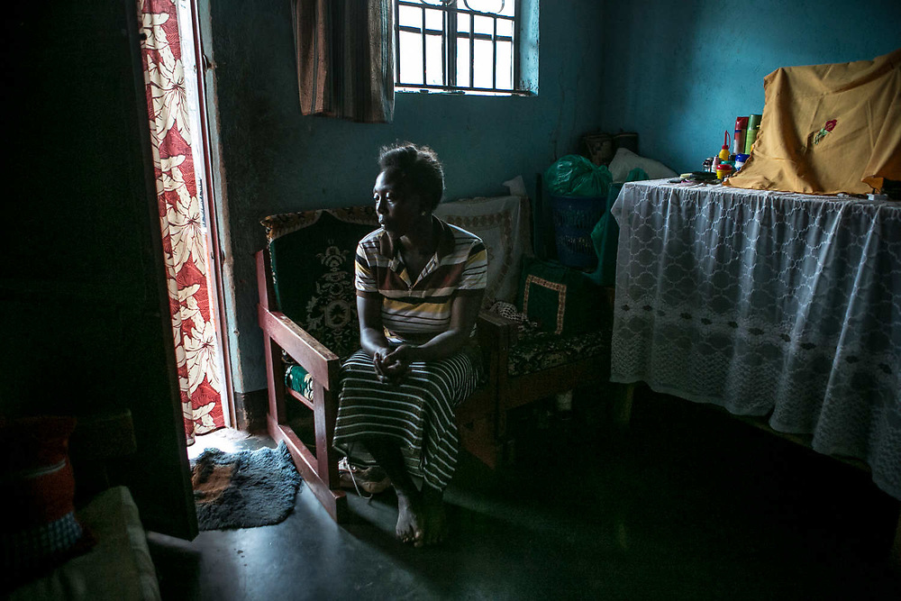 Acayo Prossy, 30, a former girl soldier and sex slave, sits in her home in Gulu. She was abducted when she was nine years old in a village in Pade. When she was 12 years old, she was assigned to a captain who had eight wives. She also fought in the frontline and gave birth to a boy with a captain, spending ten years in the bush. She escaped in 2004, but found out both of her parents have died. Her father was shot by the LRA. She now lives with four children making bags and stuffed animals.