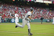 CHICAGO - OCTOBER 15:  Paul Konerko #14 of the Chicago White Sox hits a three run home run off of Ervin Santana in the first inning during Game 4 of the American League Championship Series against the Los Angeles Angels of Anaheim at Angels Stadium on October 15, 2005 in Anaheim, California.  The White Sox defeated the Angels 8-2.