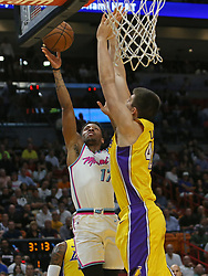 March 1, 2018 - Miami, FL, USA - The Miami Heat's Rodney McGruder goes to the basket against the Los Angeles Lakers' Ivica Zubac, right, during the first quarter at the AmericanAirlines Arena in Miami on Thursday, March 1, 2018. The Lakers won, 131-113. (Credit Image: © David Santiago/TNS via ZUMA Wire)