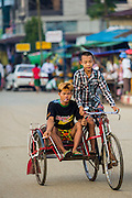 Boys on a pedicab in Pantanaw, a town in the Irrawaddy Delta (or Ayeyarwady Delta) in Myanmar. The region is Myanmar's largest rice producer, so its infrastructure of road transportation has been greatly developed during the 1990s and 2000s. Two thirds of the total arable land is under rice cultivation with a yield of about 2,000-2,500 kg per hectare. FIshing and aquaculture are also important economically. Because of the number of rivers and canals that crisscross the Delta, steamship service is widely available.