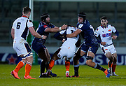 Sale Sharks prop Bevan Rodd and Sale Sharks lock JP Du Preez tackle Edinburgh Rugby full-back Blair Kinghorn during the European Champions Cup match Sale Sharks -V- Edinburgh Rugby at The AJ Bell Stadium, Greater Manchester,England United Kingdom, Saturday, December 19, 2020. (Steve Flynn/Image of Sport)