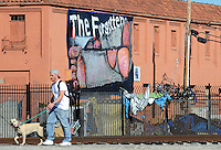 """Seen with a long lens from Pajaro Street and Market in Salinas, """"The Forgotten"""" is at least thirty feet long and was installed by art group C3 using a scissor jack."""