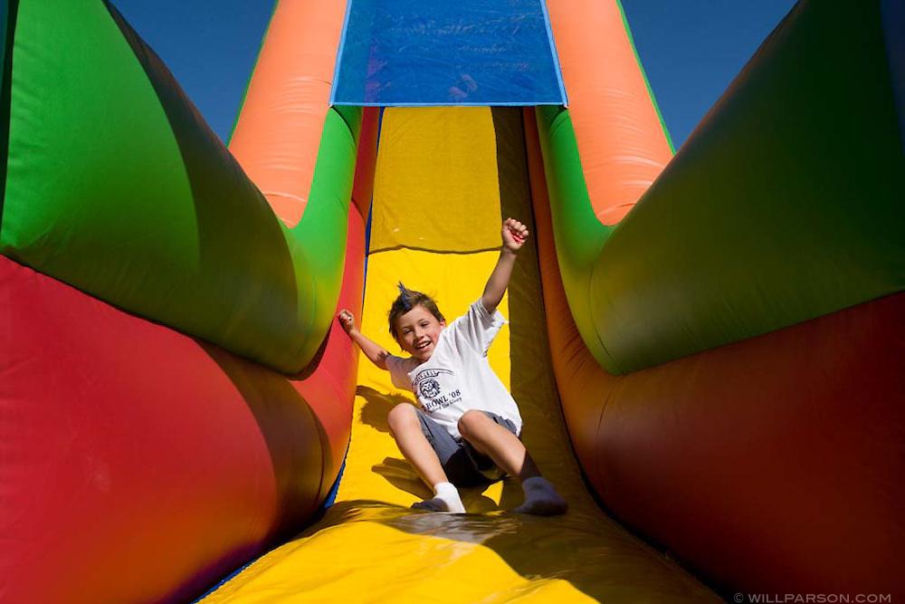 Eli Baloun enjoys the slide at the Spirit Bowl carnival during the Spirit Bowl Flag Football tournament hosted by Horizon Prep Academy on October 24, 2008 in Rancho Santa Fe.