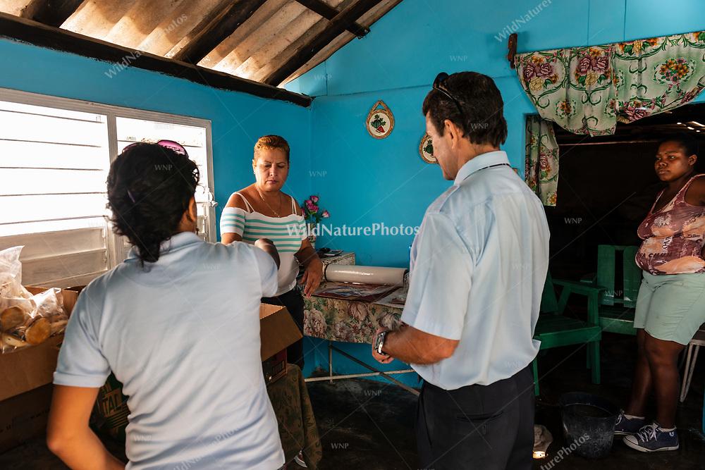 An employee sells guayaba barsa to a bus driver and tour guide at La Panchita, the factory that makes Guyaba bars. (Florida, Camagüay Province, Cuba).