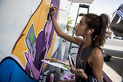 August 3, 2017 - Merced resident and artist Abigail Fuentz, 23, who goes by the name Abba Zig Zag, paints an original character she calls Baby Cobra, as part of a mural on the side of J.J. Video Games and Thrift Store, located at 222 West Main Street in Merced, Calif., on Thursday, Aug. 3, 2017. According to Fuentz, this is the first mural of this size that she has worked on. ''I want to do as much local stuff as I can,'' said Fuentz. (Credit Image: © Andrew Kuhn/The Merced Sun Star via ZUMA)