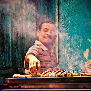 Grilling fish in the midday sun, Rashid market style.