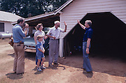 Candidate Jimmy Carter campaigns house to house as he stumps in rural North Carolina - To license this image, click on the shopping cart below -