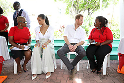 Rihanna (second left), Prince Harry and councillor Ministry of Health HIV Program Susette Neblett-Straughn (right) talk on stage in prepartion of an live HIV test, at the 'Man Aware' event held by the Barbados National HIV/AIDS Commission in Bridgetown, Barbados, during his tour of the Caribbean.