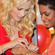 NLD/Amstelveen/20120216 - Presentatie Charityarmband Rode Kruis, Yfke Sturm en Sylvana Simons