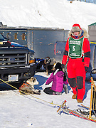 Alice White of Finland, MN, prepares for her ten-dog race on Sunday, 2 Feb 2014. Scenes from the Apostle Islands Sled Dog Race, hosted by the Bayfield Chamber of Commerce, near Bayfield, WI