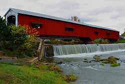 24 October 2017:  The Bridgeton Mill Covered Bridge.  Water from a recent rain saturates the falls under the bridge as fall colored trees are in abundance.<br /> <br />  Parke County Indiana is the site of the Indiana Covered Bridge Festival every October