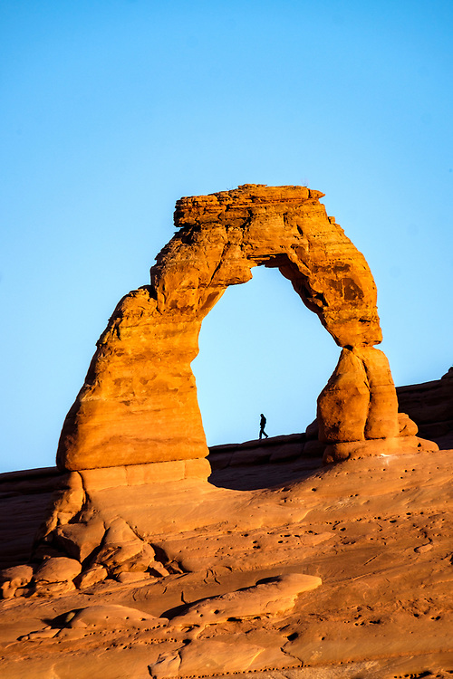 A long telephoto lens and good timing allowed for a really cool photograph of Delicate Arch.