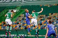 João Palhinha and Sebastián Coates reach for the head kick during the Liga NOS match between Sporting Lisbon and Belenenses SAD at Estadio Jose Alvalade, Lisbon, Portugal on 21 April 2021.