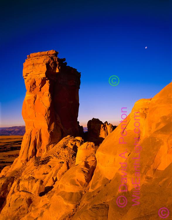 Chimney Rock with moon, early morning light, Chama Basin near Ghost Ranch, New Mexico, © David A. Ponton