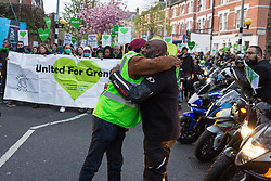 London, UK. 14th April 2019. Members of United Ride for Grenfell pay their respects to the Grenfell community and firefighters taking part in the Grenfell Silent Walk around North Kensington on the monthly anniversary of the fire on 14th June 2017. 72 people died in the Grenfell Tower fire and over 70 were injured.