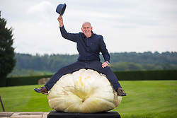 © Licensed to London News Pictures. 14/09/2018. Harrogate UK. Graham Barrat with his prize winning heaviest Pumpkin that weighed 319.8kg at the Giant Vegetable Competition today at the Autumn Harrogate Flower Show in Harrogate. Photo credit: Andrew McCaren/LNP