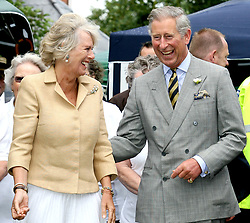 File photo dated 17/07/07 of the Duchess of Cornwall laughing with the Prince of Wales during a game of bowls while visiting to Bromham in Wiltshire. Charles and Camilla are celebrating their 15th wedding anniversary on Friday, after they were reunited on Monday when the 72-year-old duchess came out of a 14-day self-isolation on the Balmoral estate in Aberdeenshire.