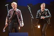 Ed Sheeran and Macklemore performing at the iHeartRadio Music Festival in Las Vegas, Nevada on Sepembter 20, 2014.
