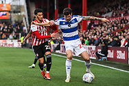 Queens Park Rangers Midfielder Pawel Wszolek (23) and Brentford Forward Said Benrahma (21) battle for the ball during the EFL Sky Bet Championship match between Brentford and Queens Park Rangers at Griffin Park, London, England on 2 March 2019.