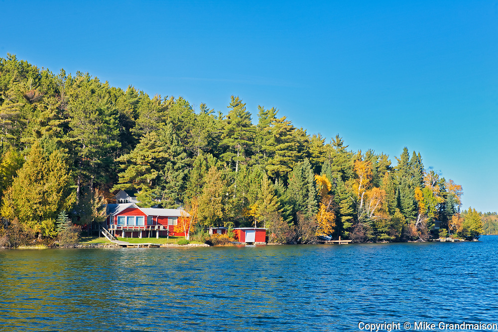 Dock and cottages and Autumn on Crow Lake (also known as Kakagi Lake).<br /><br />Ontario<br />Canada