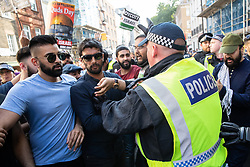 © Licensed to London News Pictures. 10/06/2018. London, UK. Police hold back Al Quds Day marchers as Jewish and pro-Israeli protesters block the route of the annual Al Quds day march in support of the Palestinian cause, in central London. Photo credit: Joel Goodman/LNP