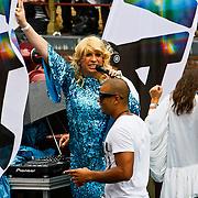 NLD/Amsterdam/20100807 - Boten tijdens de Canal Parade 2010 door de Amsterdamse grachten. De jaarlijkse boottocht sluit traditiegetrouw de Gay Pride af. Thema van de botenparade was dit jaar Celebrate, Mayday