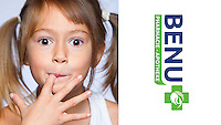 little girl licking her fingers and looking delighted with the taste. Advertising photograph for Benu Pharmacy