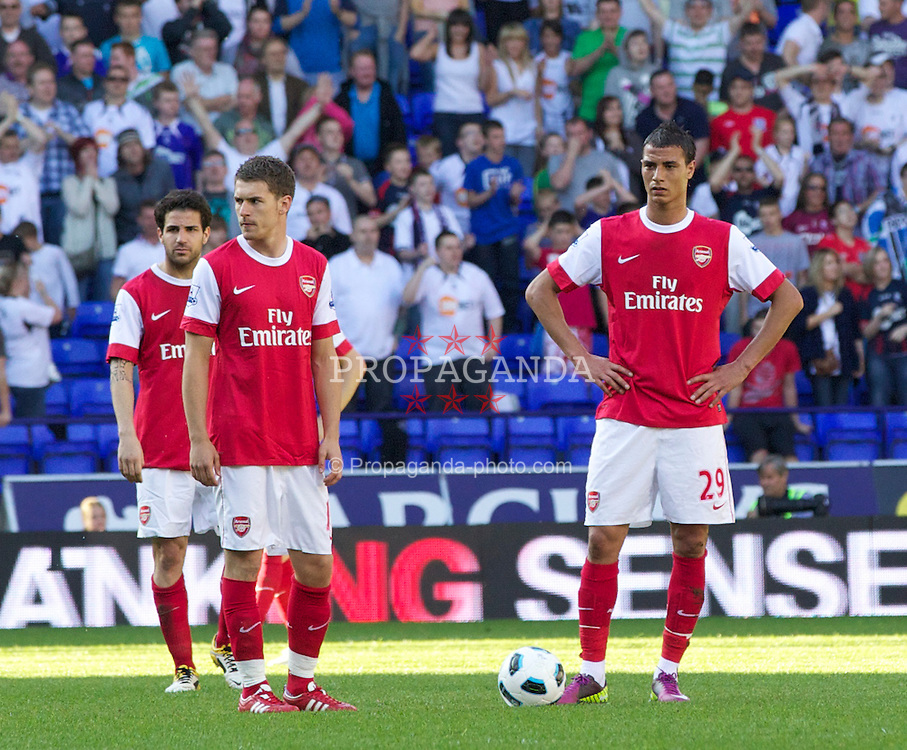 BOLTON, ENGLAND - Sunday, April 24, 2011: Arsenal's Aaron Ramsey, captain Francesc Fabregas and Marouane Chamakh look dejected as Bolton Wanderers scores the winning 2-1 goal during the Premiership match at the Reebok Stadium. (Photo by Vegard Grott/Propaganda)