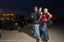 Photo Assistants (L-R) Garrett Stanley, Shannon Kerr and Melissa Shoemaker at the Broken Spoke County Line during the 75th Annual Sturgis Black Hills Motorcycle Rally.  SD, USA.  August 7, 2015.  Photography ©2015 Michael Lichter.