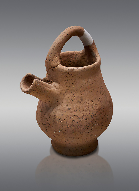 Hittite terra cotta side spout with strainer basket handle pitcher. Hittite Period, 1600 - 1200 BC, Ortakoy Sapinuva . Ortakoy Sapinuvwa . Çorum Archaeological Museum, Corum, Turkey .<br />  <br /> If you prefer to buy from our ALAMY STOCK LIBRARY page at https://www.alamy.com/portfolio/paul-williams-funkystock/hittite-art-antiquities.html  - Ortakoy  into the LOWER SEARCH WITHIN GALLERY box. Refine search by adding background colour, place, museum etc<br /> <br /> Visit our HITTITE PHOTO COLLECTIONS for more photos to download or buy as wall art prints https://funkystock.photoshelter.com/gallery-collection/The-Hittites-Art-Artefacts-Antiquities-Historic-Sites-Pictures-Images-of/C0000NUBSMhSc3Oo