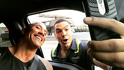 """Dwayne Johnson releases a photo on Instagram with the following caption: """"Yeah but sometimes traffic is just gonna have to wait to make fans happy \ud83d\ude09\nI was driving in my pick up truck after work and my guy here pulled up beside me, recognized me and started freaking out. I rolled the passenger window down to say hello and then he REALLY freaked out. Jumped out of his rig and came around to my side where he stood in the oncoming traffic lane. \nHe said, \"""". Photo Credit: Instagram *** No USA Distribution *** For Editorial Use Only *** Not to be Published in Books or Photo Books ***  Please note: Fees charged by the agency are for the agency's services only, and do not, nor are they intended to, convey to the user any ownership of Copyright or License in the material. The agency does not claim any ownership including but not limited to Copyright or License in the attached material. By publishing this material you expressly agree to indemnify and to hold the agency and its directors, shareholders and employees harmless from any loss, claims, damages, demands, expenses (including legal fees), or any causes of action or allegation against the agency arising out of or connected in any way with publication of the material."""