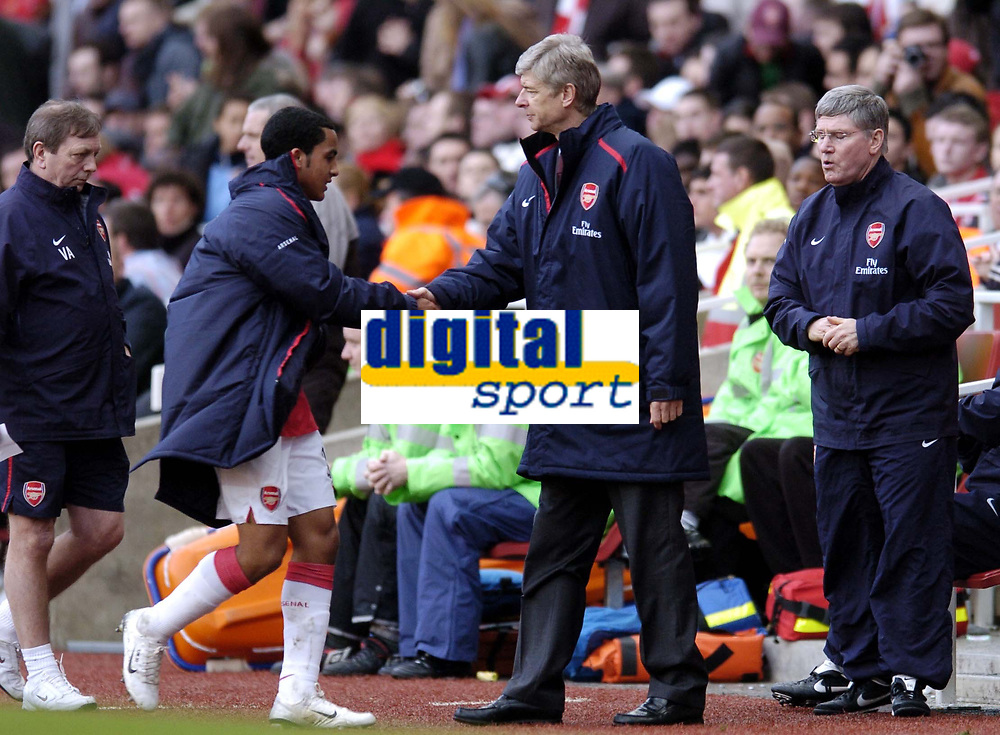 Photo: Olly Greenwood.<br />Arsenal v Reading. The Barclays Premiership. 03/03/2007. Arsenal manager Arsene Wenger congratulates Theo Wallcot on a good perfomance after being substituted