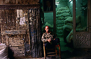 A man sits outside his shop in the Souk in Aleppo. The Souk is the longest covered market in the Middle East and parts can be dated to Roman times. The entire covered Souk can be dated from the sixteenth century. Goods ranging from food to jewellery can be purchased here.