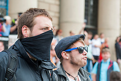 EDL return to Sheffield to lay flowers at Sheffield War Memorial<br /> <br /> 12:59  Barkers Pool on the steps of Sheffield City Hall a masked Anti EDL protestors his feelings known to the EDL  <br /> <br /> 8 June 2013<br /> Image © Paul David Drabble<br /> www.pauldaviddrabble.co.uk