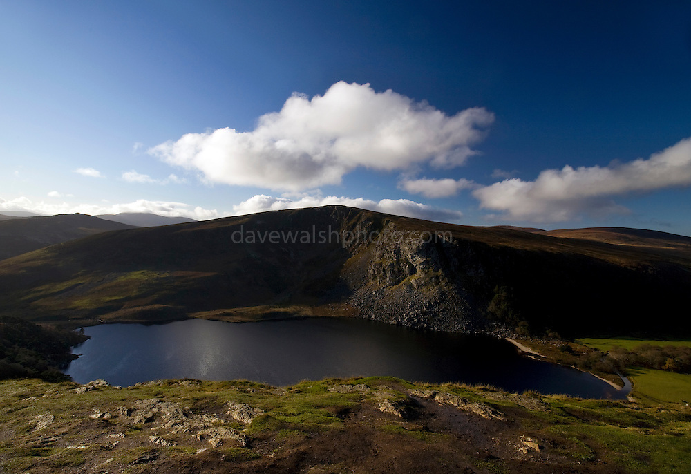 Lough Tay, in the Wicklow Mountains, Ireland. Fed by the Cloghoge river, it borders an estate owned by the Guinness family. The white sand, imported by the landowners, makes the lake look like a pint of Guinness.