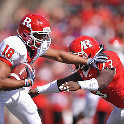 Apr 24, 2010; Piscataway, NJ, USA; White wide receiver Julian Hayes (18) stiff arms Scarlet linebacker Ka'Lial Glaud (13) during Rutgers Scarlet and White intersquad NCAA football scrimmage at Rutgers Stadium. The Scarlet squad defeated the White, 16-7.
