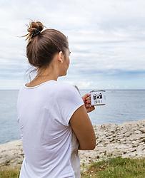 THEMENBILD - eine Frau mit einer Kaffeetasse aus Metall am Morgen an der Adria, aufgenommen am 28. Juni 2018 in Pula, Kroatien // a woman with a metal coffee cup in the morning on the Adriatic Sea, Pula, Croatia on 2018/06/28. EXPA Pictures © 2018, PhotoCredit: EXPA/ JFK