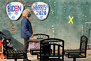 "16 OCTOBER 2020 - PERRY, IOWA: A woman waits for a ""Get Out the Vote"" event with Doug Emhoff, the husband of Vice Presidential Candidate Kamala Harris. Emhoff spoke to a group of about 30 people. The crowd was socially distanced and masks were required in  keeping with CDC and state of Iowa health guidelines to deal with the COVID-19 pandemic. Emhoff is traveling throughout Nebraska and Iowa today, campaigning on behalf of the Biden/Harris ticket.         PHOTO BY JACK KURTZ"