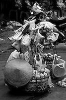 A street vendor 's overflowing baskets of goods.
