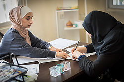 16 February 2020, Irbid, Jordan: Referral officer Manal Ali Al-Husban (left) receives a Syrian refugee at the Lutheran World Federation community centre in Irbid. The centre offers psychosocial support to Syrian refugees in Jordan.