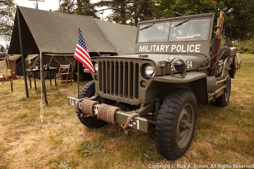 USA, Oregon, Astoria, Ft. Stevens State Park, military police jeep, WWII living history encapment.
