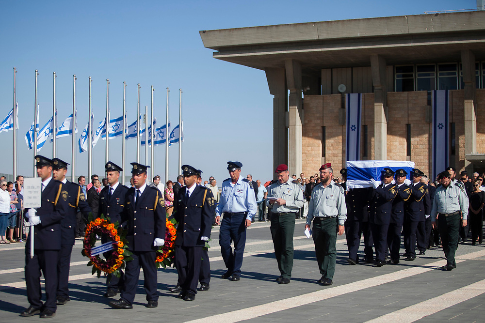 Members of the Israeli Knesset honor guard carry the flag draped coffin of former Israeli Prime Minister Yitzhak Shamir, prior to the state funeral procession, at the Knesset, Israel's parliament in Jerusalem, on July 2, 2012. Shamir, who served as Israel's prime minister for seven years, died on Saturday at the age of 96.