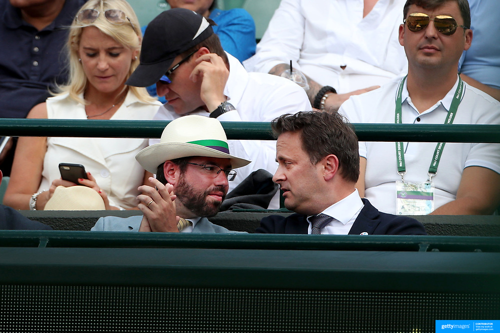 LONDON, ENGLAND - JULY 12:  Prince Guillaume, Grand Duke of Luxembourg (left) and Luxembourg's Prime Minister Xavier Bettel watching Gilles Muller of Luxembourg in action against Marin Cilic of Croatia in the Mens' Singles Quarter Final match on Court One during the Wimbledon Lawn Tennis Championships at the All England Lawn Tennis and Croquet Club at Wimbledon on July 12, 2017 in London, England. (Photo by Tim Clayton/Corbis via Getty Images)
