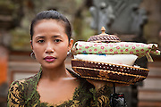 Apr 24 - UBUD, BALI, INDONESIA: A woman brings gifts to a funeral for Bali's royal family in Ubud, Bali. Photo by Jack Kurtz/ZUMA Press